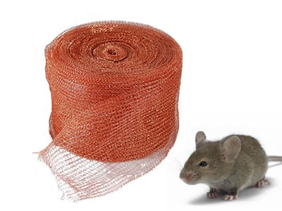 A mouse beside the roll of copper knitted wire mesh.
