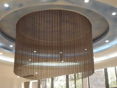 Superior The Picture Shows A Round Copper Metal Mesh Curtain Hanging On Ceiling For  Lamp Decoration.