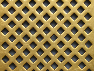 The picture shows a piece of diamond brass perforated mesh.