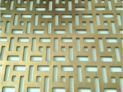 The picture shows a piece of five rectangles brass perforated mesh.