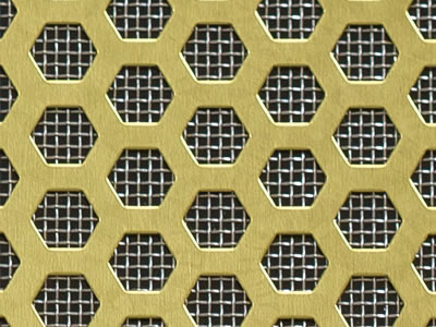 The picture shows a piece of hexagon brass perforated mesh with the background of low carbon steel woven mesh.