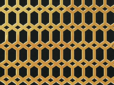 The picture shows a piece of honey comb brass perforated mesh.