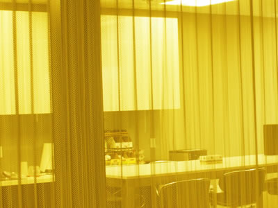 The Picture Shows The Metal Mesh Curtain Used As Space Divider In The  Office.