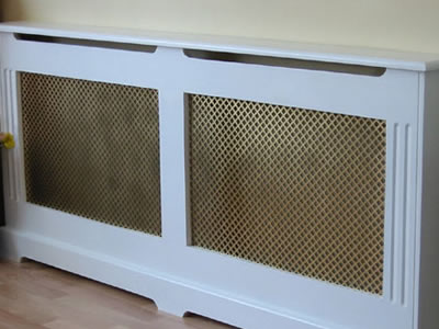 Merveilleux The Picture Shows A White Cabinet With Two Brass Perforated Mesh Screen.