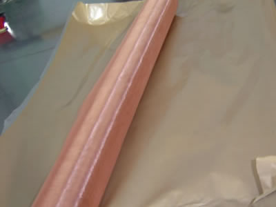 The picture shows a roll of phosphor copper cloth on the waterproof paper.