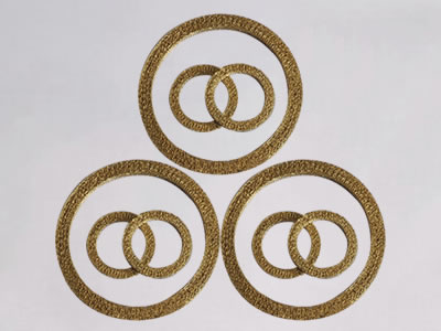 The picture shows three big and six small ring compressed knitted wire mesh.