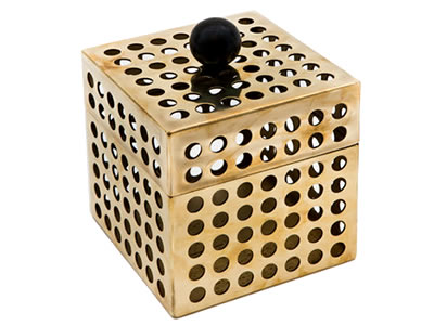 A box made of round brass perforated mesh with a black ball on the top.