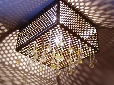 Round perforated mesh with crystal falls around the light.