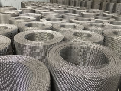 Many rolls of stainless steel window screen in our warehouse.